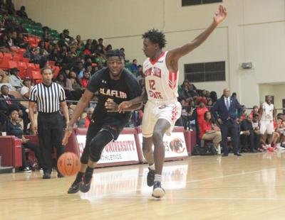 Claflin's Moore drives to the basket
