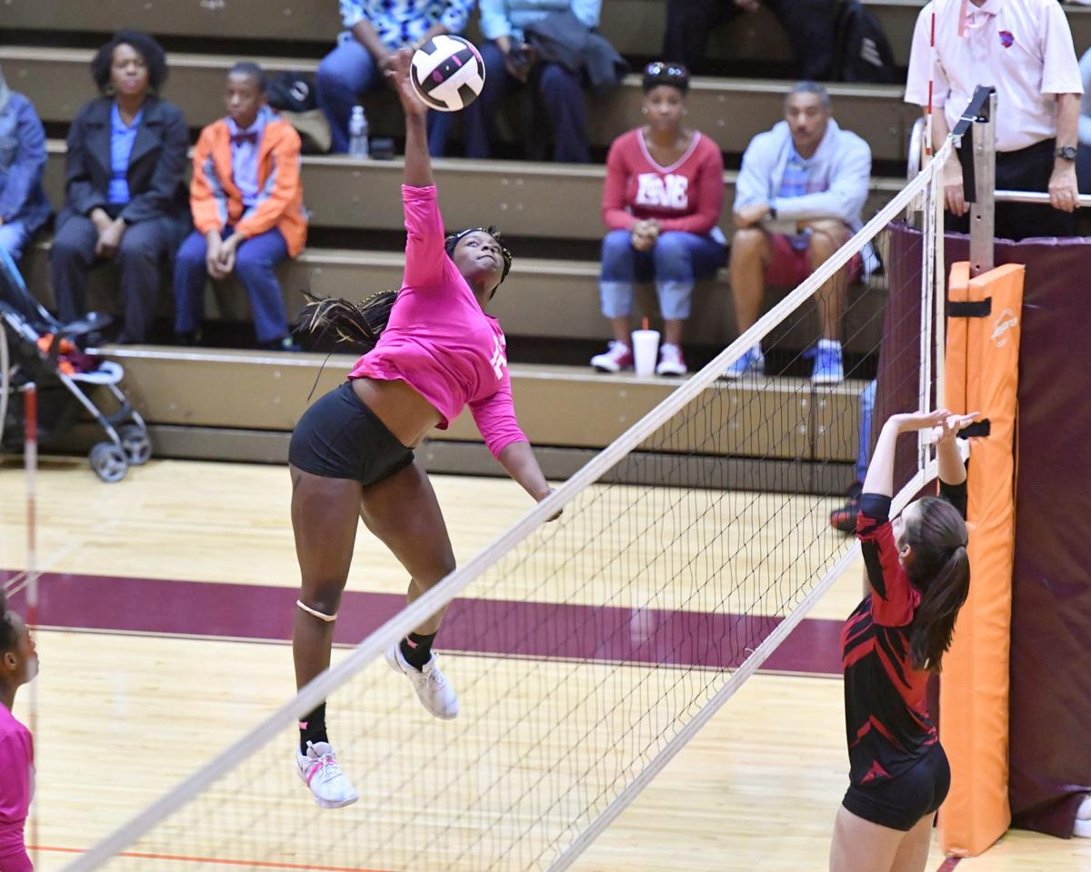 Berry swings on a kill in O-W volleyball win