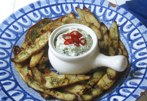 Potato skins baked with roasted garlic rosemary butter and an onion kale dip