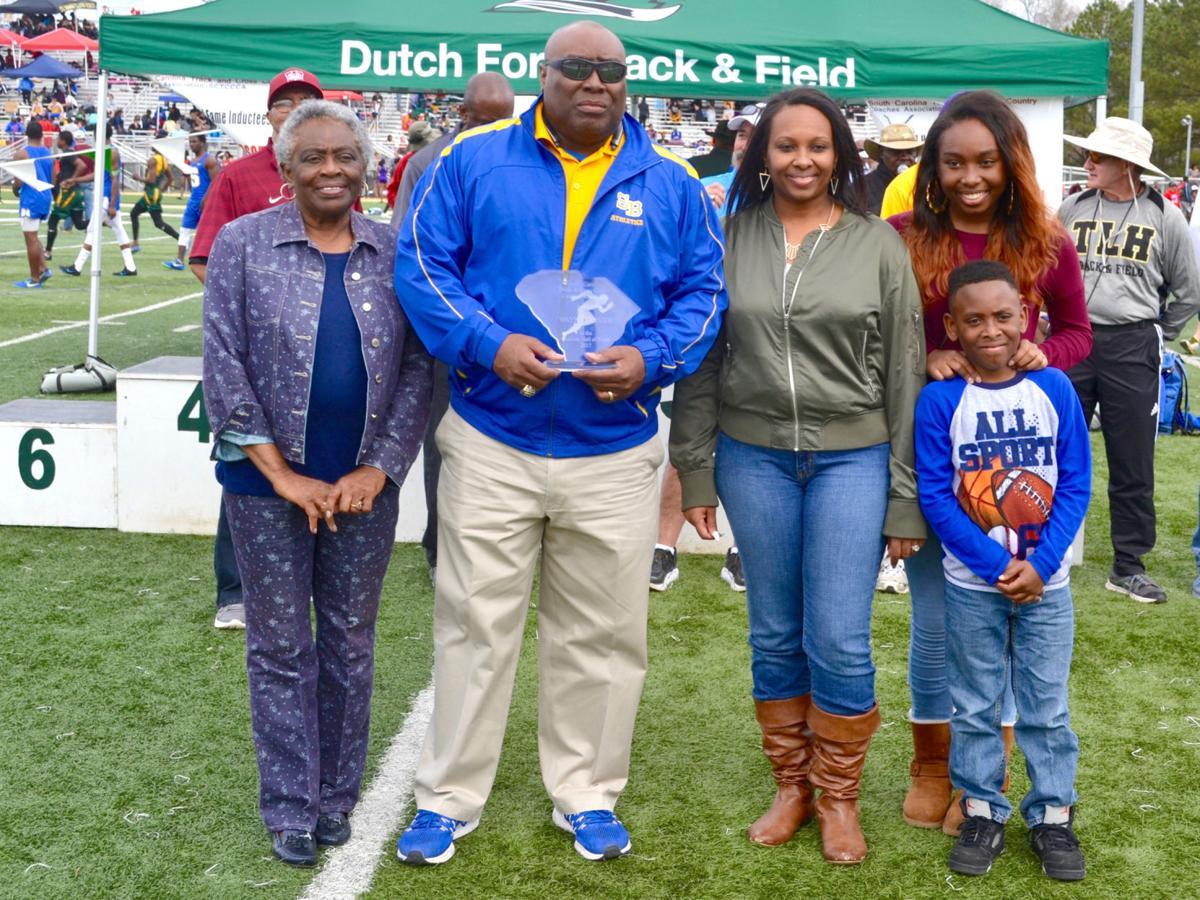Wayne Farmer - track coach with family