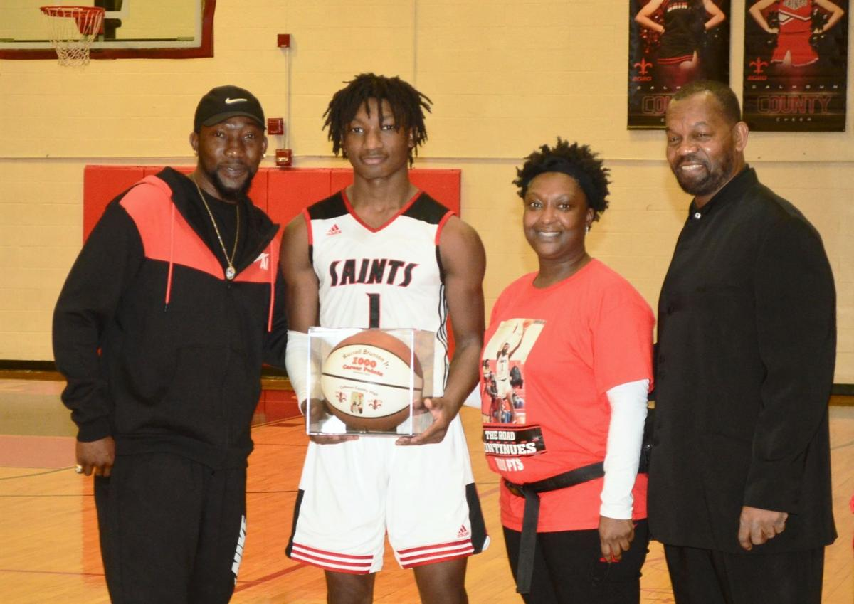 Brunson accepts his 1,000-point game ball