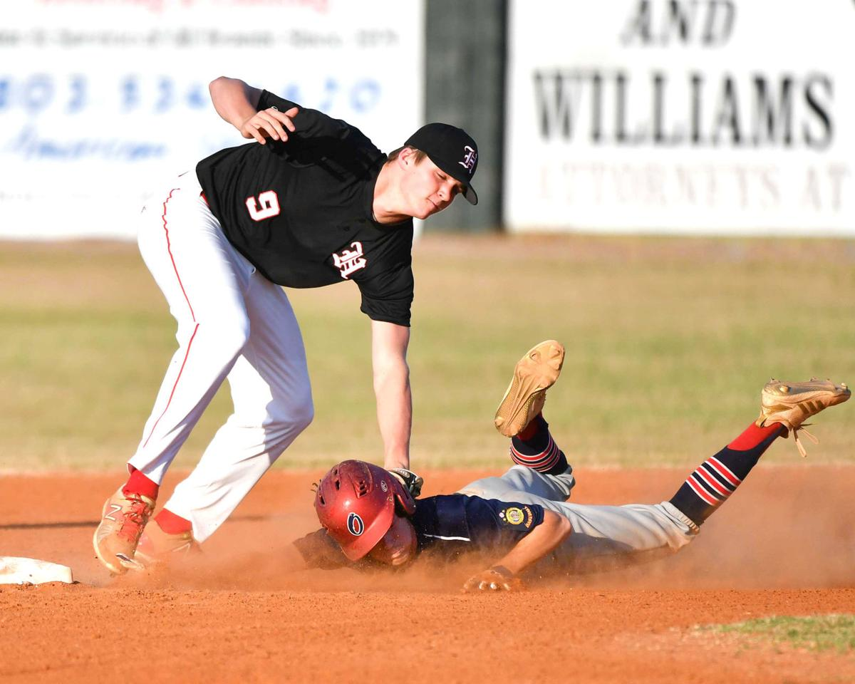 Post 4 base runner Hunter Bauer is tagged out trying to steal second base