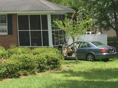 Vehicle hits house