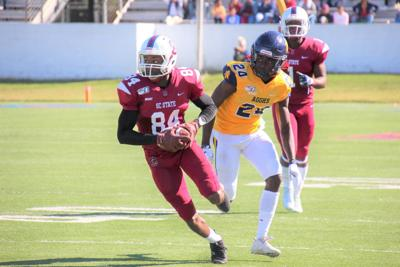 Thomas runs with the ball for State