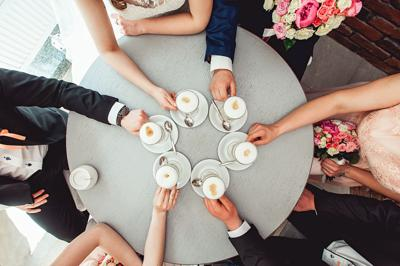 People holding in hands cups with coffe.