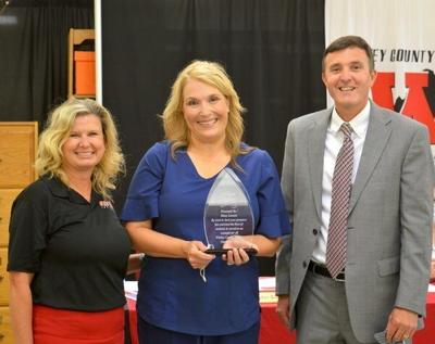 Nurse Lawson honored with Above and Beyond Award by Whitley schools