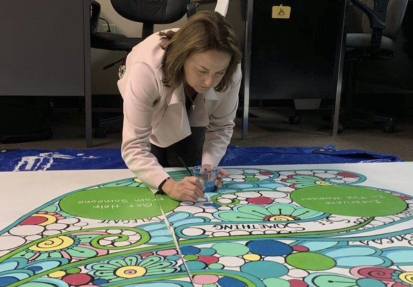Community paints sections of <span>Cumberland River Green Dot mural</span>