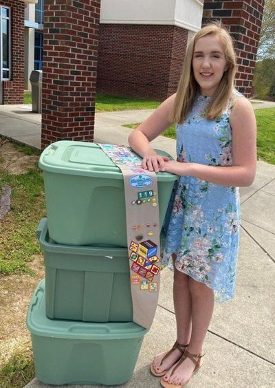 Catelin Ball earns Girl Scout's highest award for science activities libraries