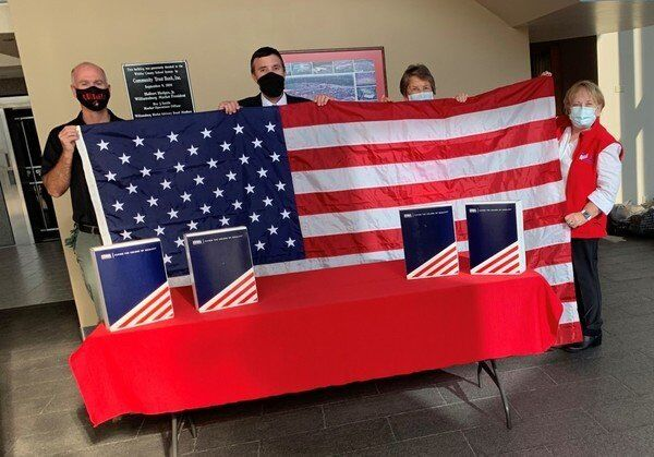 Local chapters of Sons and Daughters of the American Revolution provide new flags to Whitley schools
