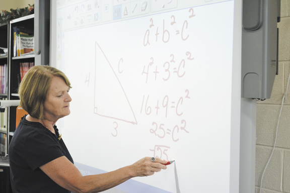 Laurel County Adult Education and Literacy instructor Lindsey LaBore takes  a moment to explain a math problem to students taking GED classes at the  Laurel ...