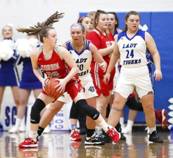 Nine Lady Redhounds score during 62-40 victory