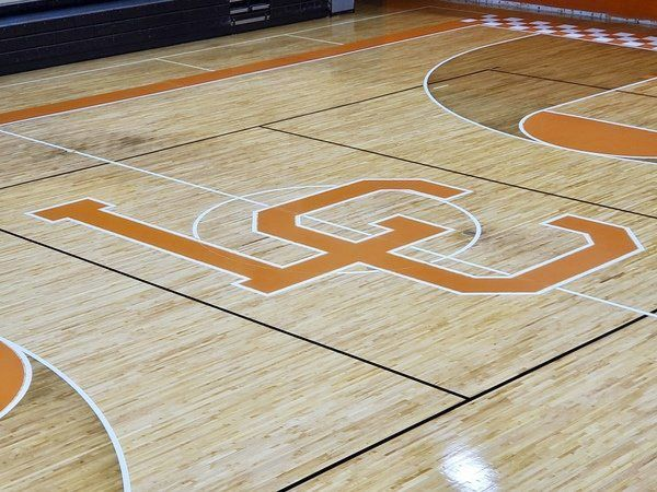 NEW DIGS FOR 'THE CAT'S DEN':<span>Lynn Camp High School's gymnasium receives a new floor design</span>