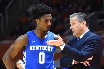 Ashton Hagans and John Calipari
