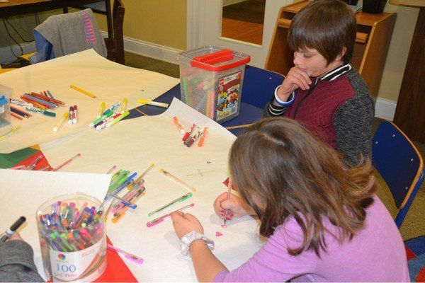 Children design own wrapping paper during library event
