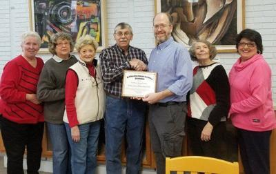 Retired teachers, library partnership helps feed the hungry