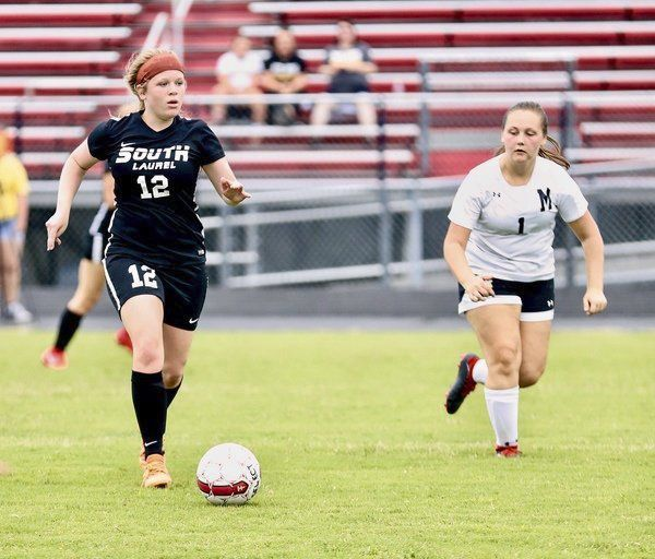 TAKING CARE OF BUSINESS:<span>Katie Vance scores three goals during South Laurel's 6-1 win over Middlesboro</span>