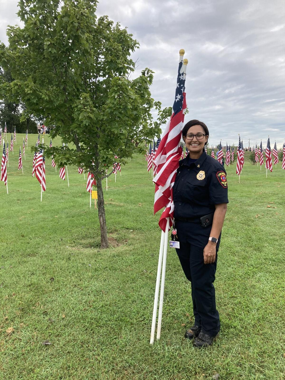 LFD member collects her flag