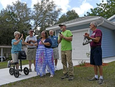 Villages club builds, Dedicates first home