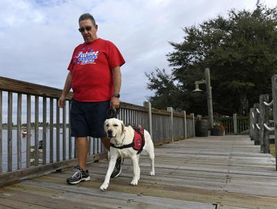Villagers help pair veterans with dogs