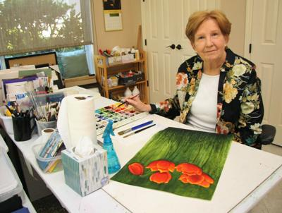 Resident creates colorful floral arrangements with paints