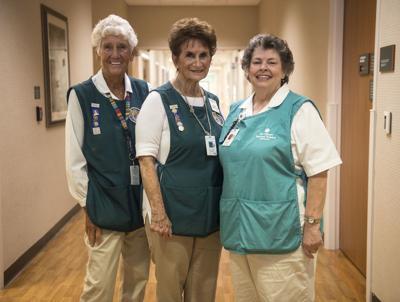 3 Volunteers tote up 10K hours of caring