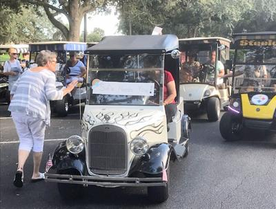 Neighbors organize golf cart parade for friend