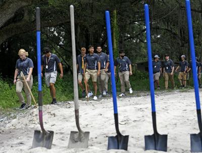 Students, community partners break ground on house