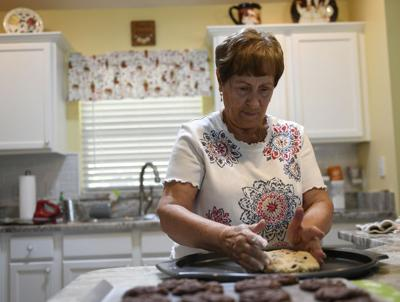 Residents baking Christmas cookies to send to troops