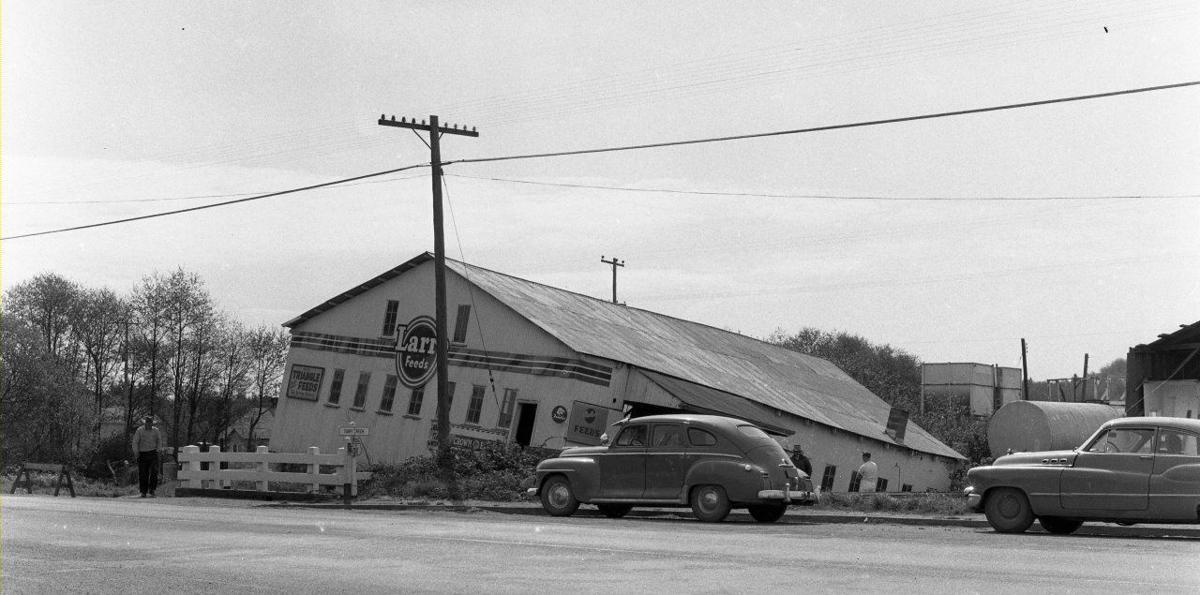 Feed store falling into Ferry Creek, 1956.