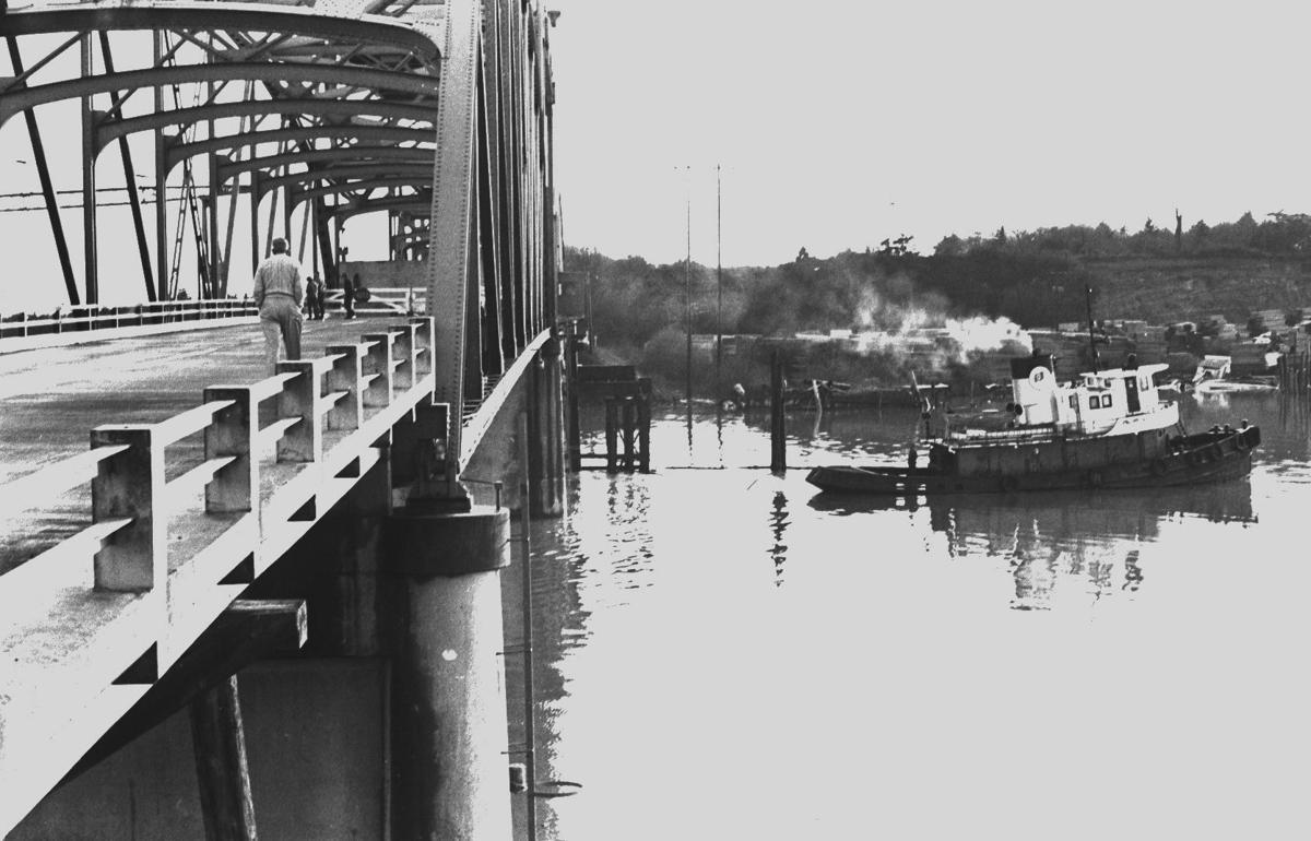 Tug guides the Oliver Olson barge under Bullards Bridge, headed to Rogge Lumber, 1966