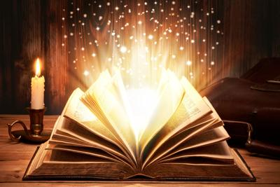 Magical old book with sparkles