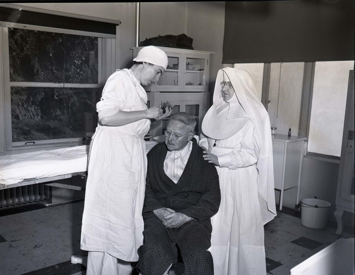 McAuley Hospital nurses and patient, 1950