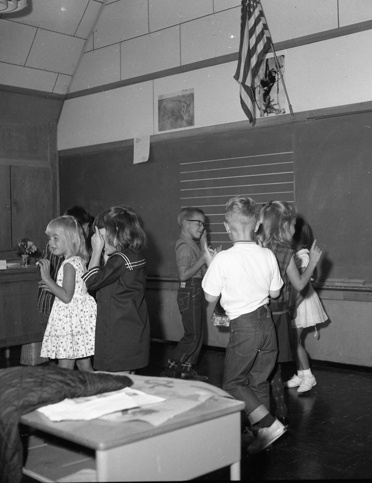Children do the hokey-pokey in the Bandon Heights School in 1966