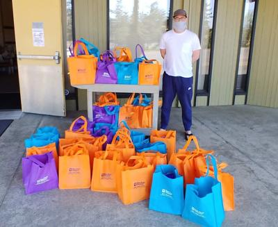 Pastor Eric Lindsey, North Bend First Presbyterian Church, with Kids' HOPE bags