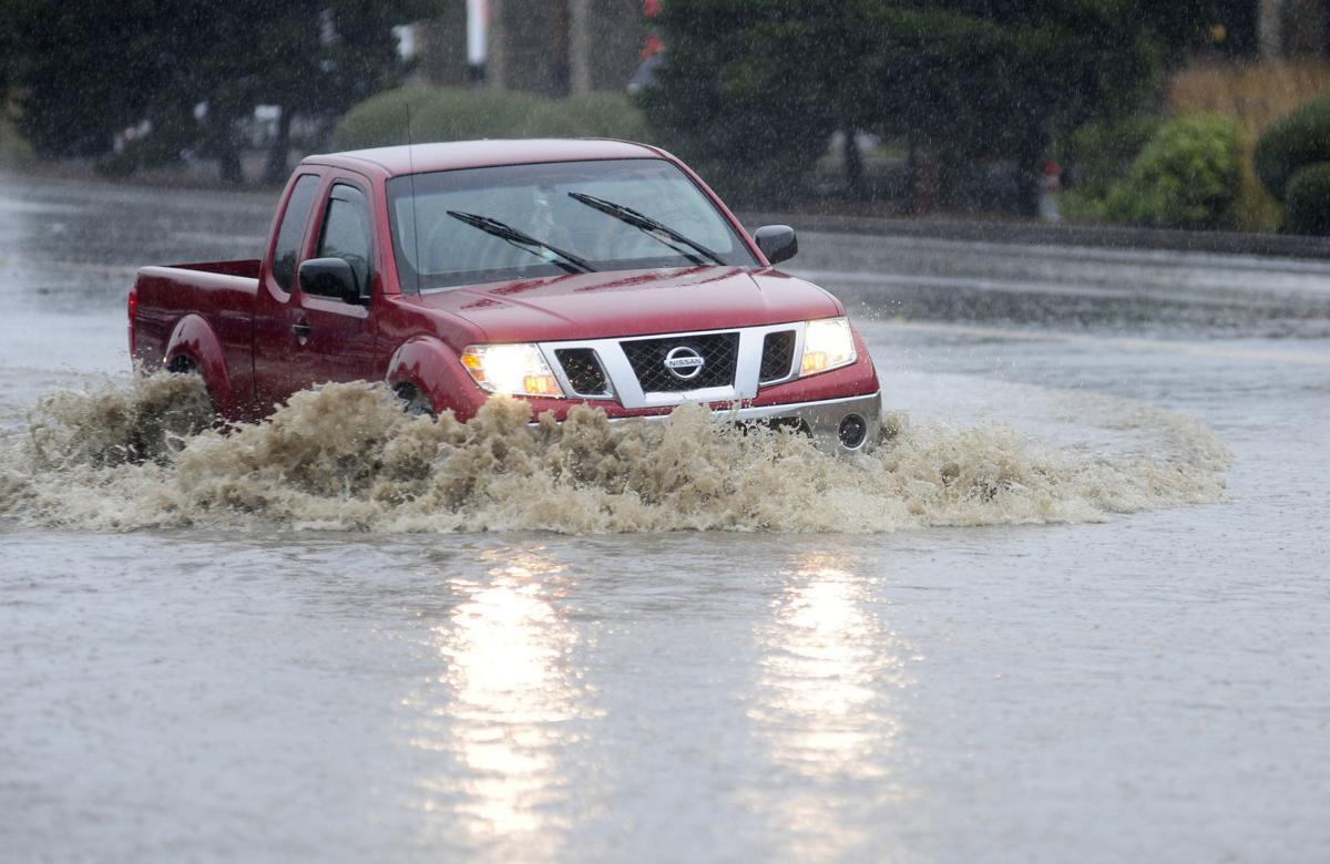 Heavy rains flood Hwy 101