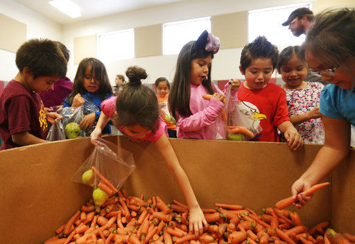 Students at Warm Springs school savor free produce program