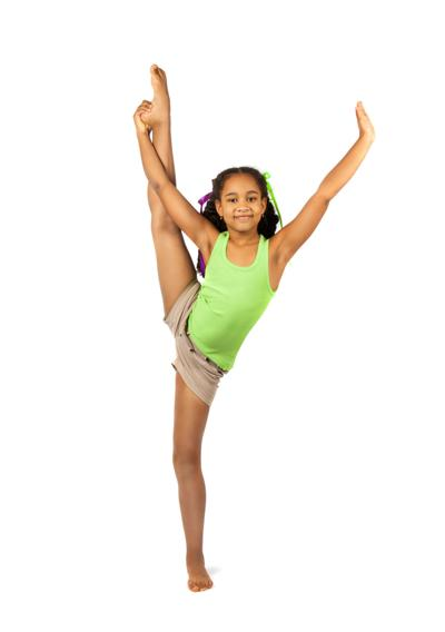 Girl gymnast in training. Isolation on a white background
