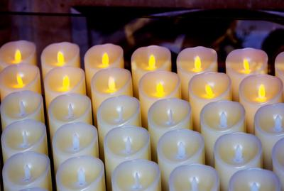 Partly lighted modern plastic candles in a church