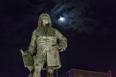 Monument to George Frideric Handel in Halle, Germany, at night.