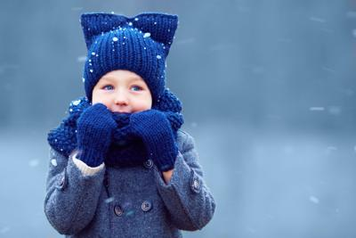 kid in winter clothes snow mittens
