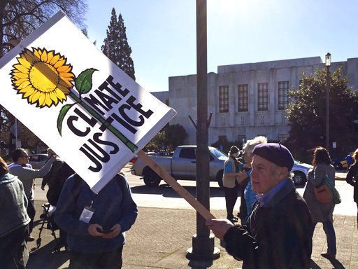 Hundreds besiege Oregon Capitol for cap on greenhouse gases