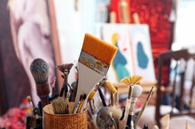 Artist brushes in a studio art supplies artist