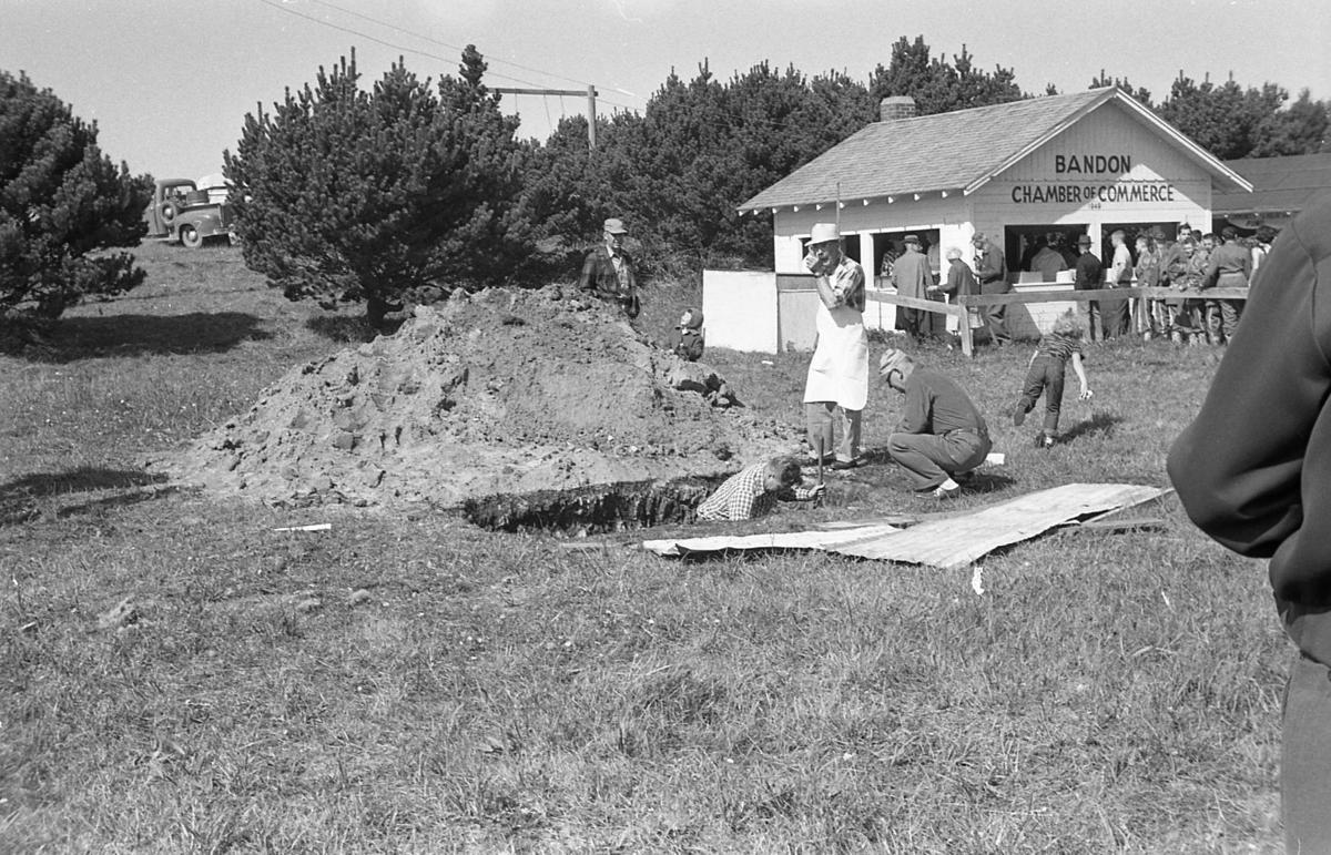 Lions Cranberry Festival barbecue 1962, Myron Spady in pit, Ernie Wehner at right