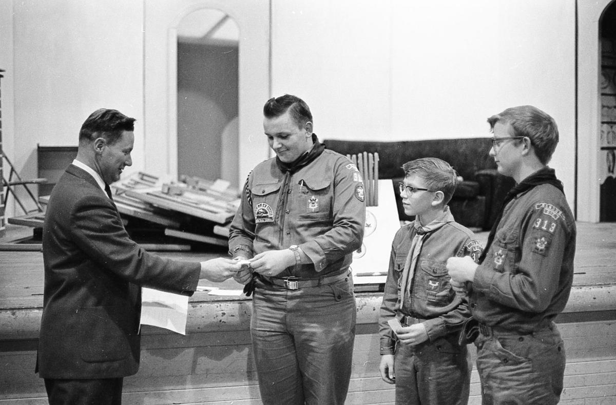 Myron Spady hands award to Gary Wallace at Scout Court of Honor, 1966