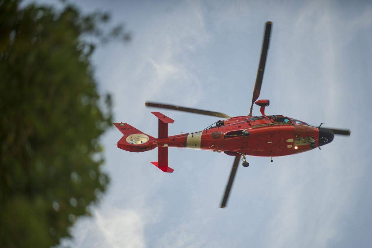 U.S. Coast Guard helicopter searching for missing man