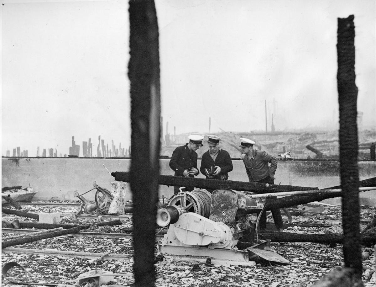 Crew looks over ruins of Coast Guard building, Bandon Fire, 1936