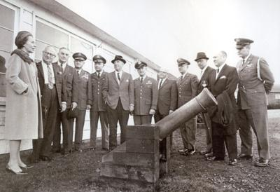 Esther Millard and others with the cannon outside the Millard Military academy