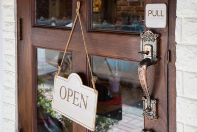 wooden sign board hang on wooden door of shop Open sign