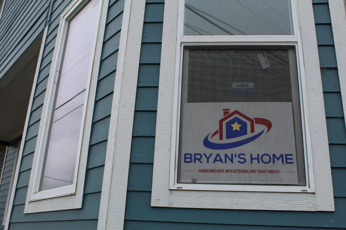 Bryan's Home logo in window