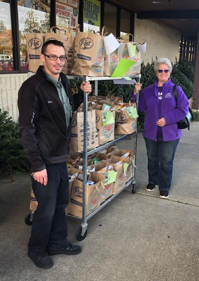 Ray's Food Place donates to Bear Food Cupboard